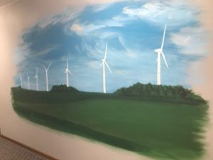 Mural of wind turbine farm managed by Nick Hildreth. Painted by Cory Witt.